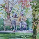 Lucienne et Robert assis sur un banc au soleil.