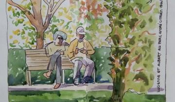 """Un couple d'un certain âge, en train de lire, sur un banc au soleil. Texte : """"LUCIENNE ET ALBERT AU PARC ANDRE CITROEN. 19.04.2015"""""""
