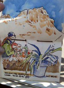 """Au premier plan une plante verte, au 2ème plan deux 2 skieurs attablés, au fond la montagne sous le ciel bleu. Texte """"DOLOMITES 2050 M LAS VEGAS LODGE. 19.03.2016"""". Signé BR."""