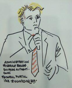 """Homme en buste parlant au micro. Blond, cravate rayé rouge et blanche. texte """"Administration fédérale belge. Sources authentiques. Fédéral portal biz #egov2016. Pilote in the Benelux area"""" Signé BR"""