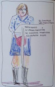 """Femme debout derrière un pupitre. Texte """"44 countries, 480 participants. Présidente ruban Sketchers de Memphis Tennessee. Elizabeth Alley"""""""