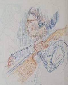 Violoncelliste (femme) en train de jouer.